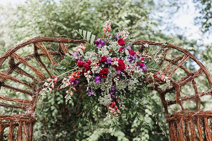 Rustic summer wedding ceremony arch