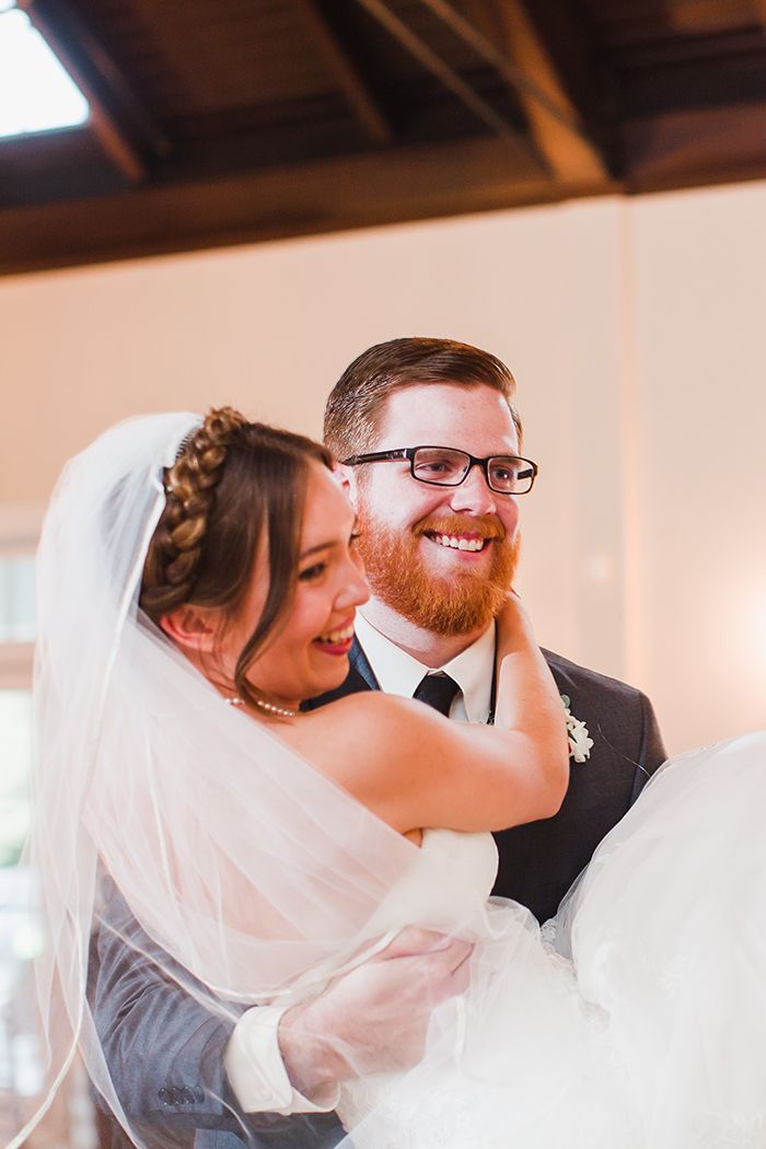 Sweet photo of the bride and groom at the reception