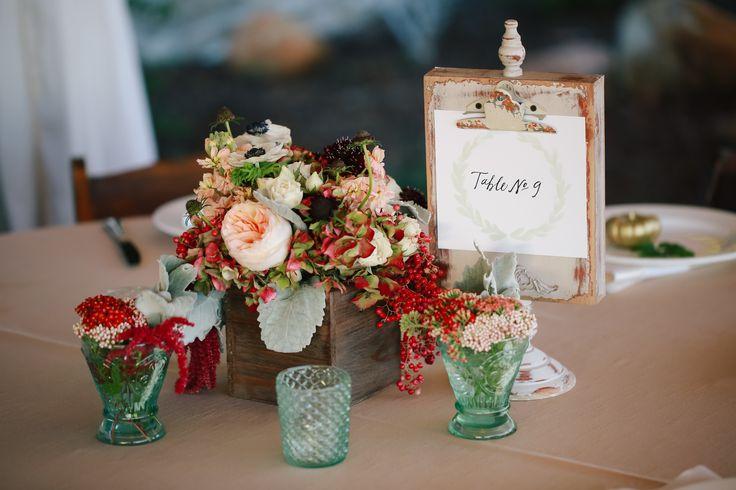Rustic red wedding flower decor for a fall wedding