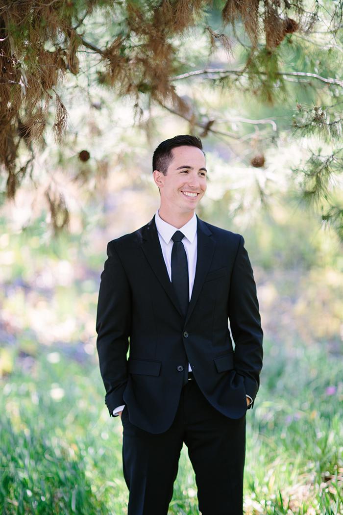 Handsome groom in a dapper suit