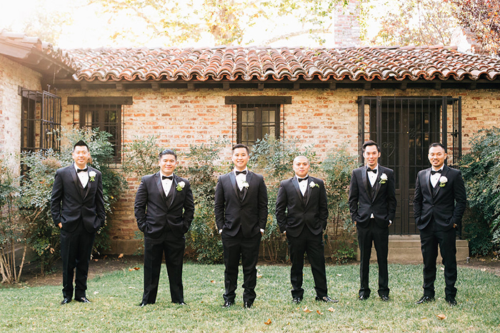 Dapper groomsmen in classic tuxes