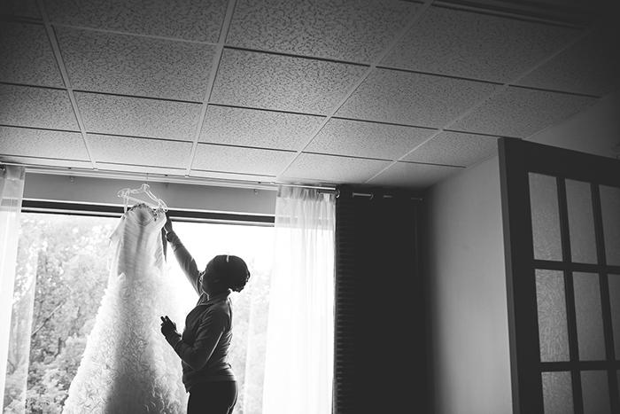 Beautiful ruffled wedding dress and the bride getting ready!