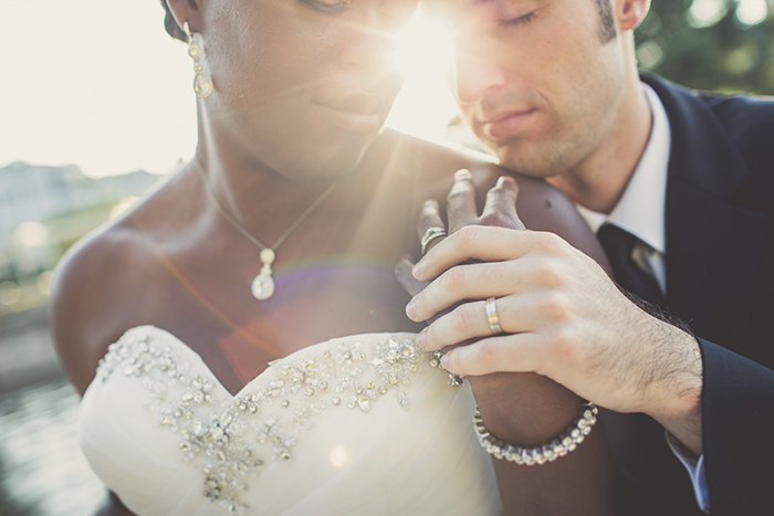 Stunning wedding day photo — show off his ring, too!