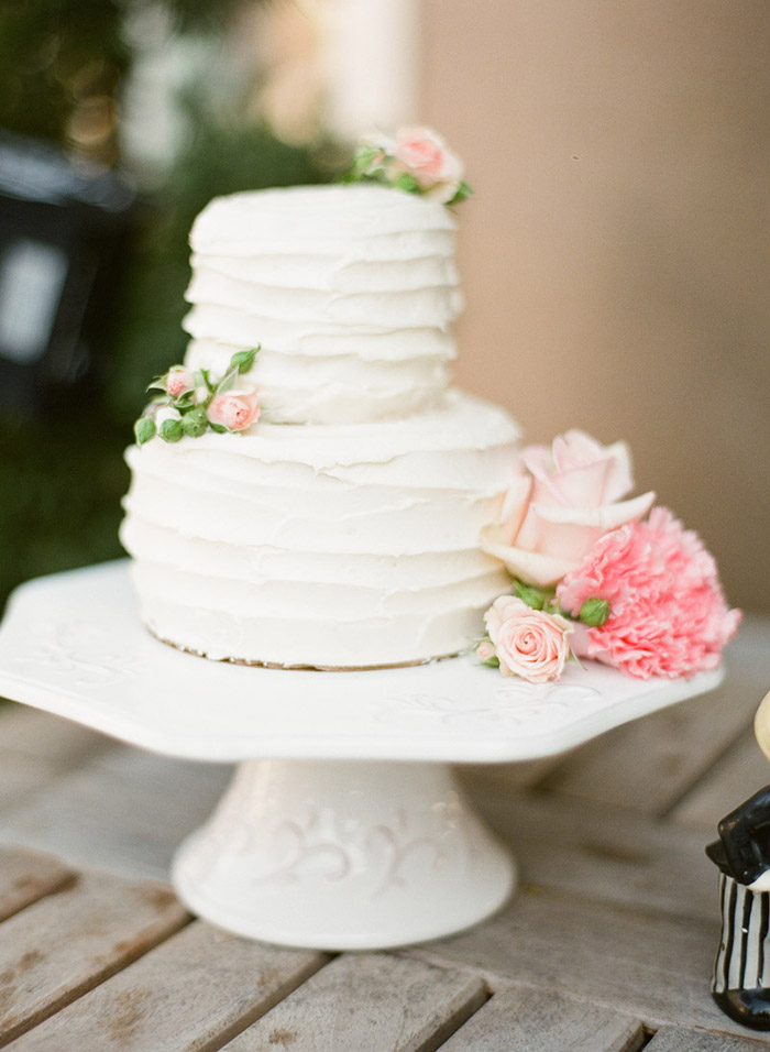 Rustic white and pink wedding cake