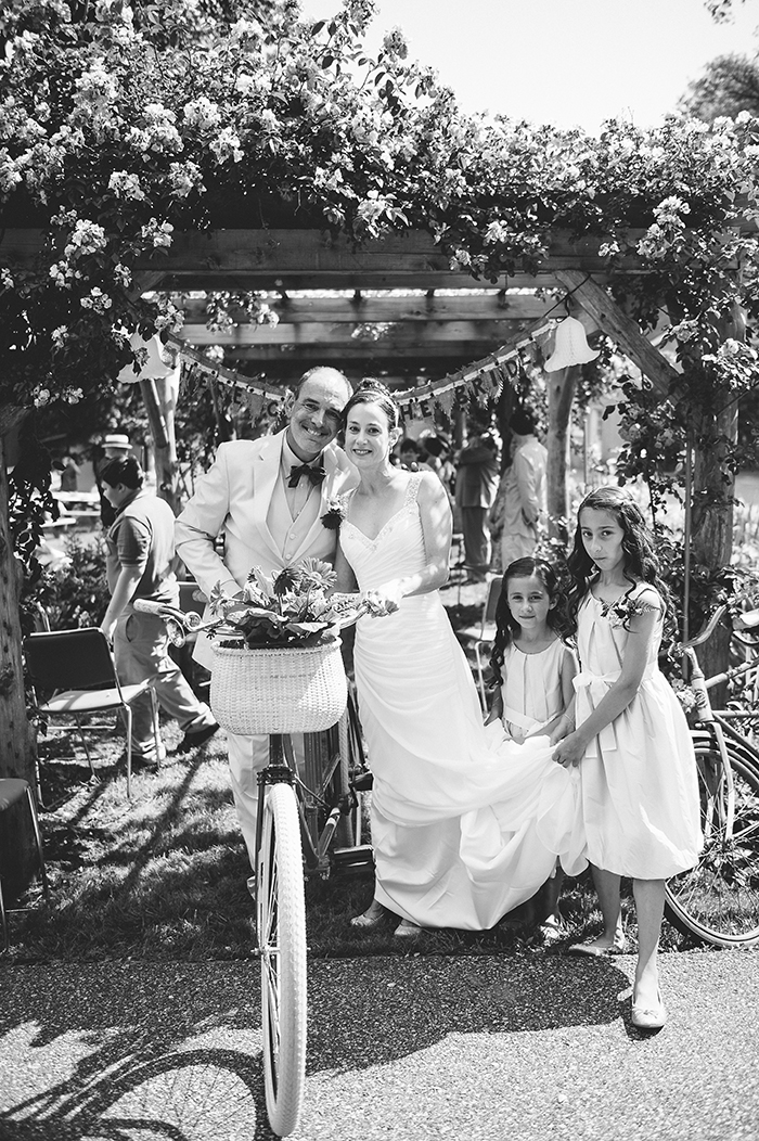 Sweet photo of the bride, groom and their flower girls