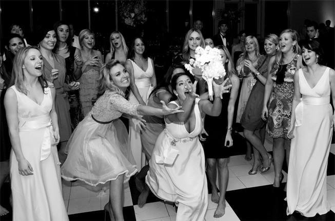 bouquet toss bridesmaid catching bouquet at wedding wedding party blog