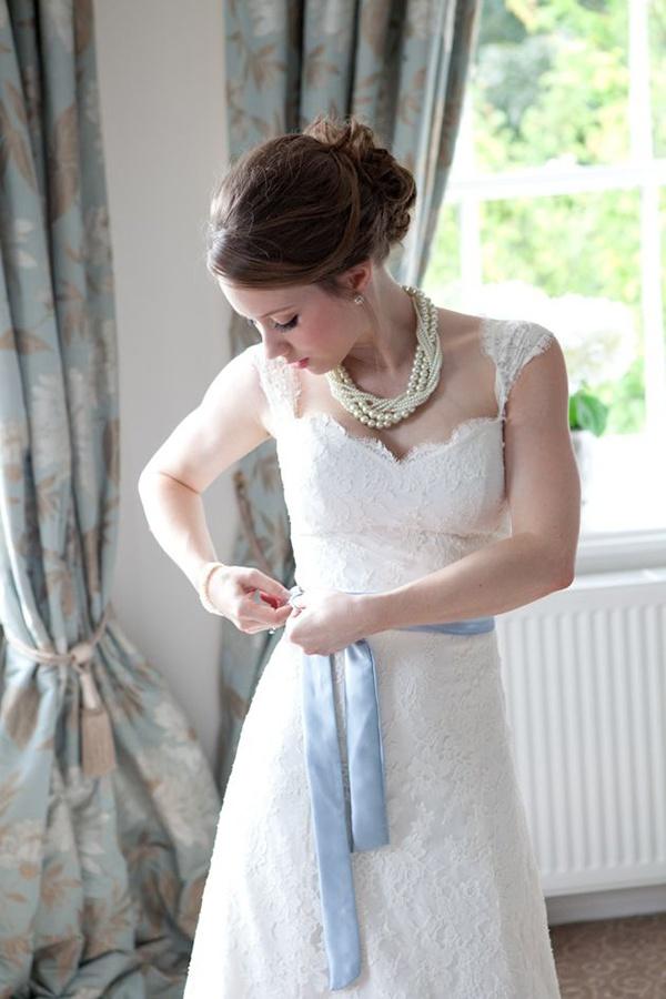 something blue, bridal traditions, wedding traditions, bride, groom, wedding, wedding inspiration, blue sash, lace wedding dress