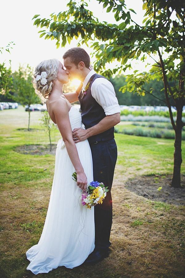 bride groom kissing sunset photo
