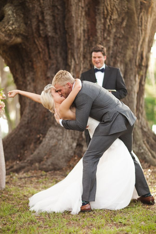 12 most epic wedding kiss photos of all time wedpics blog bride groom ceremony kiss junglespirit Gallery