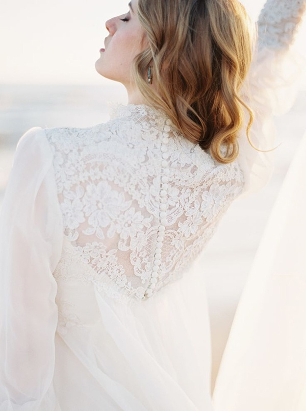Button up lace back wedding dress with sheer sleeves on this classic wedding dress