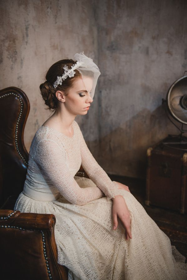 Vintage patterned wedding dress with long sleeves and a sweet veil