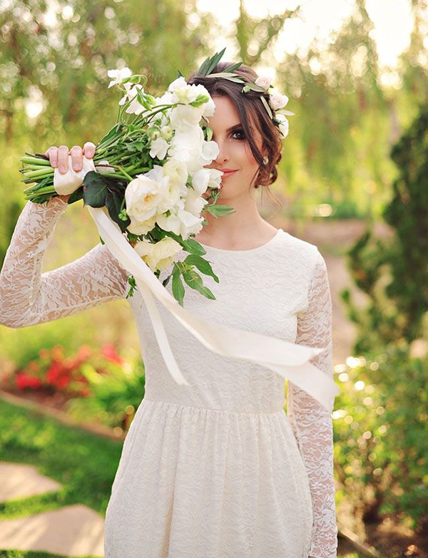 Sweet and modest lace long sleeve wedding dress with white bouquet. So pretty!
