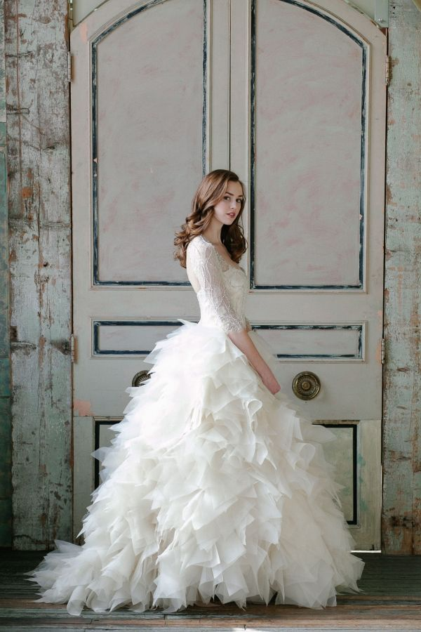 Fluffy wedding dress! Love this with the beaded top and long sleeves