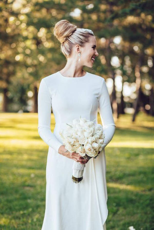 Simple minimalist wedding dress with long sleeves