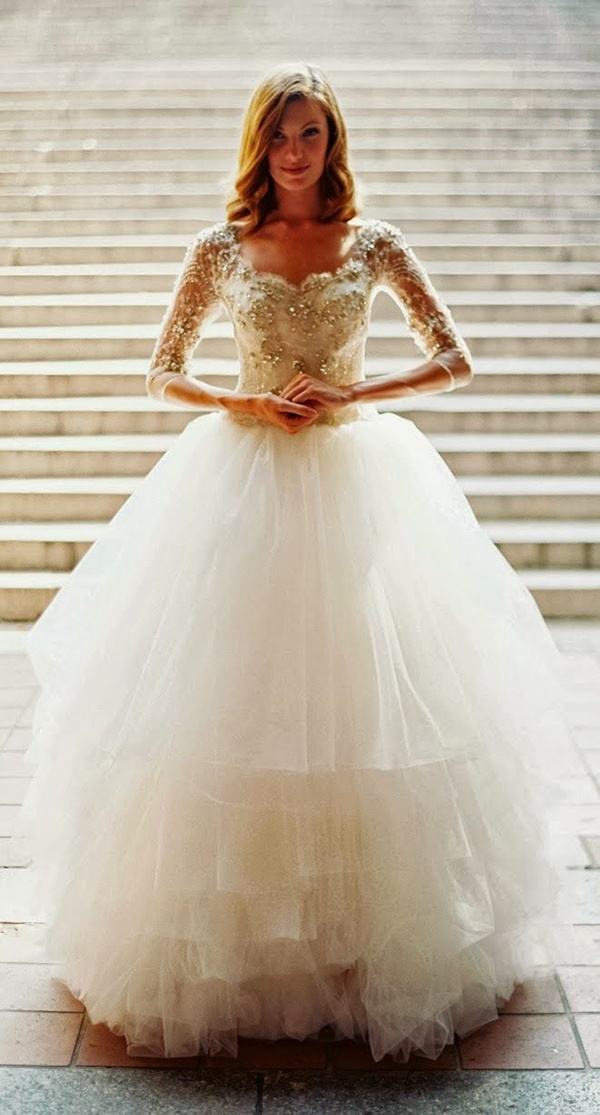 Fairy tale princess wedding dress with long sleeves and a poofy tulle skirt! Love!