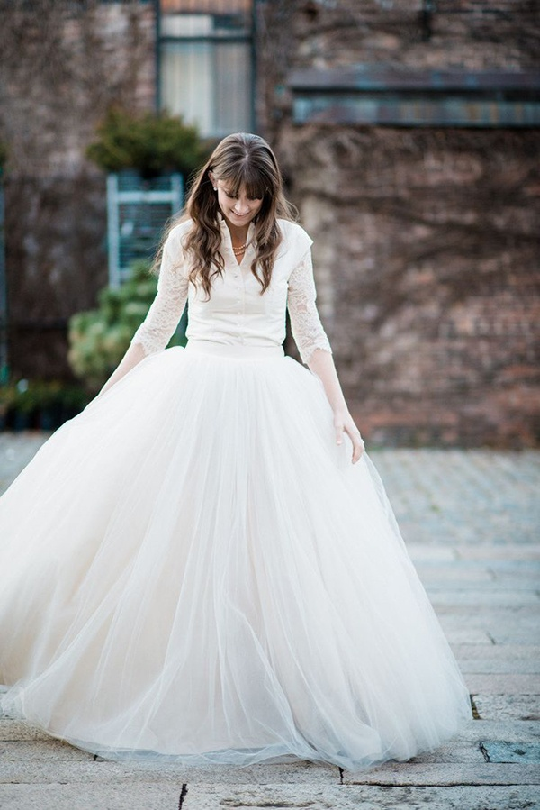 Love this unusual but totally bridal wedding dress with long sleeves!