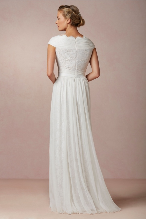 Elegant Bhldn wedding dress under $500. Check out the post for more affordable finds!