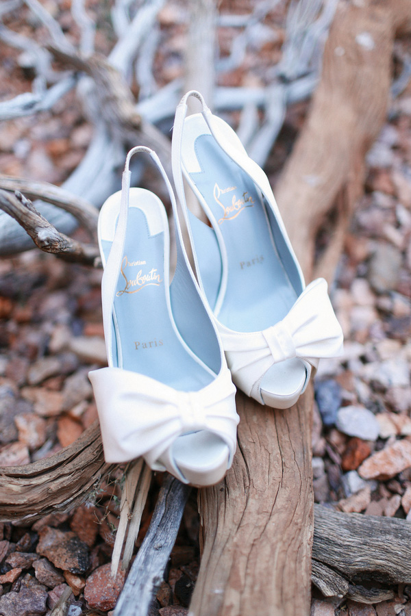White Loboutin shoes for the bride
