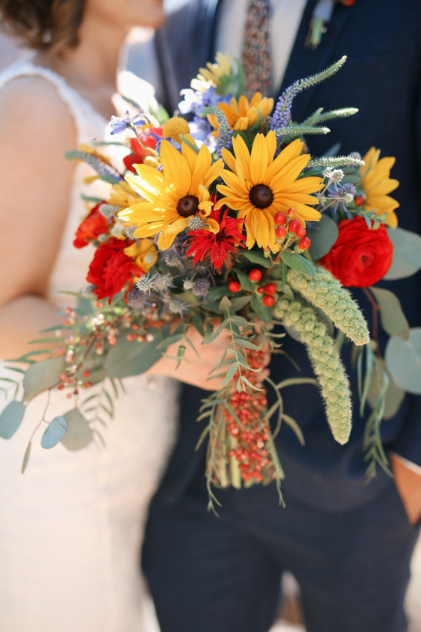 Beautiful yellow and red wedding bouquet with daisies! So pretty!