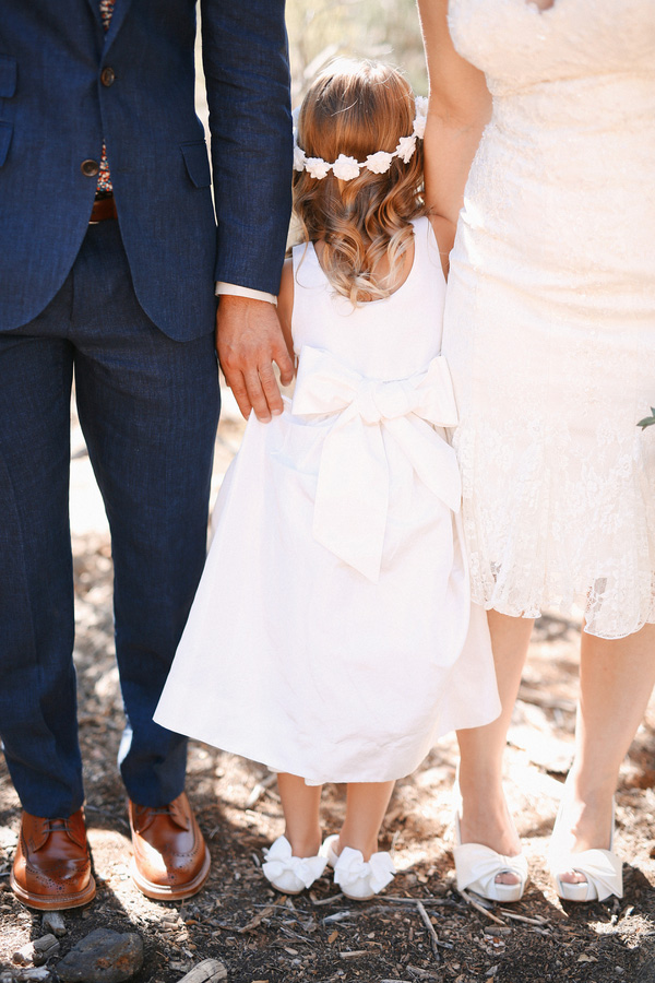 Gorgeous and romantic photo of the bride, groom and their daughter at their carnival themed desert wedding!