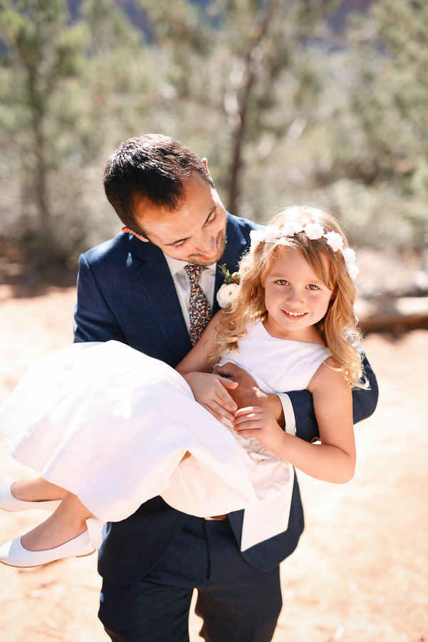Gorgeous and romantic photo of the flower girl and the groom, her dad, at this carnival themed desert wedding!