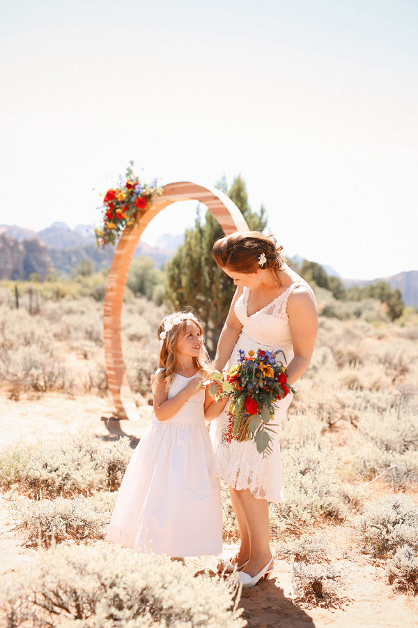 Gorgeous and romantic photo of the bride and her daughter at their carnival themed desert wedding!