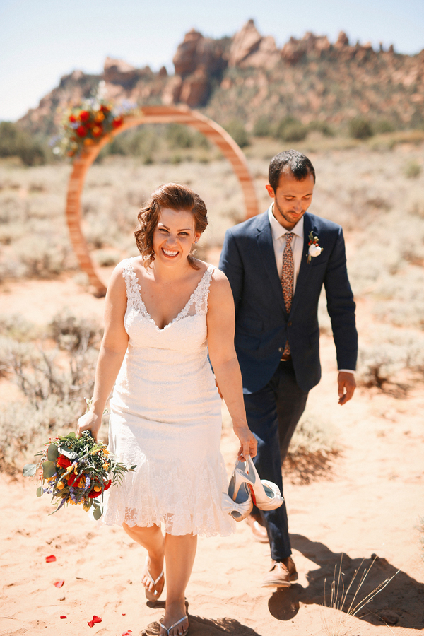 Gorgeous and romantic photo of the bride and groom at their carnival themed desert wedding!