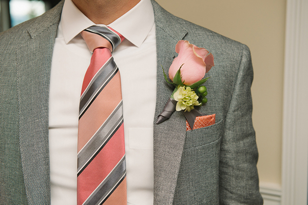 Coral rose groom boutonniere