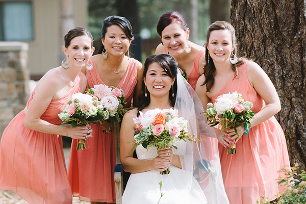 Sweet photo of the bridesmaids in coral dresses