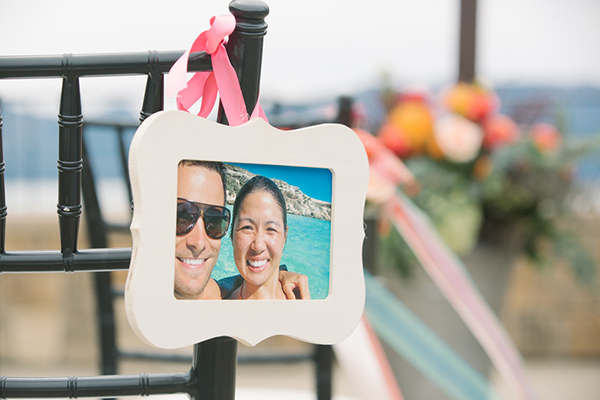 Sweet idea for wedding ceremony aisle decor: photos of your life together