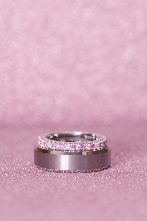 The bride's wedding band has pink diamonds. So pretty!