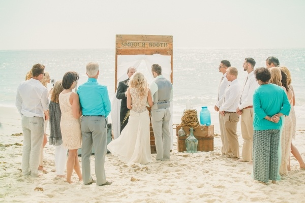 Gorgeous small beach wedding ceremony. More lovely photos from this wedding in the post!