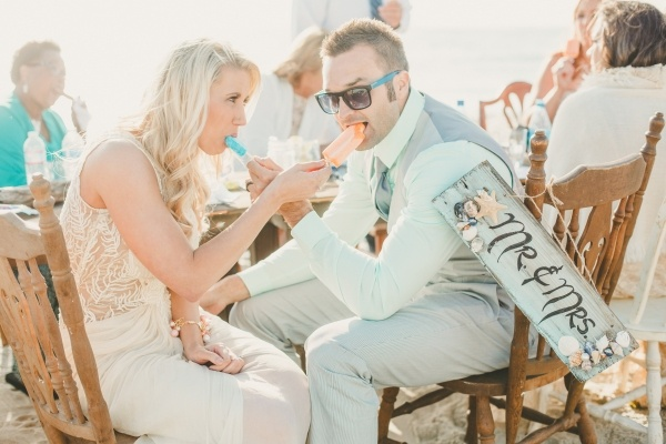 Popsicles make for a fun treat at a low key rustic beach wedding reception!