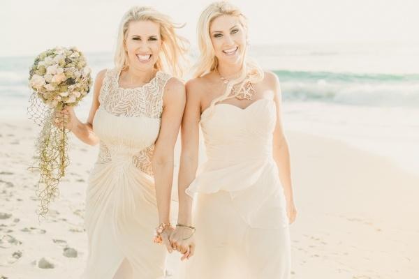 bride and bridesmaid at a small low key beach wedding!