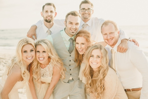 Friends with a newly married bride and groom at a small stunning beach wedding!
