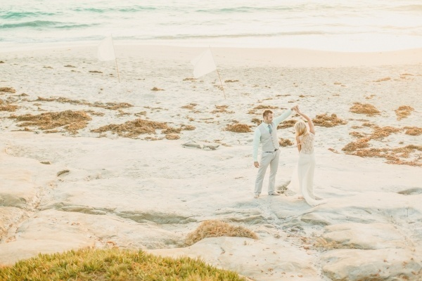 Bride and groom enjoying the beach as newlyweds!