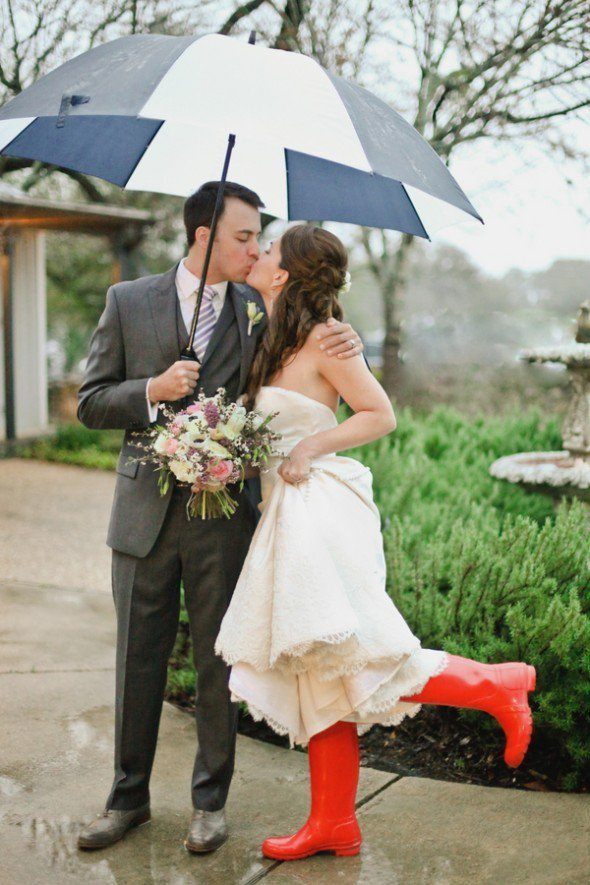 Bright red rain boots make for super fun rainy day wedding photos!