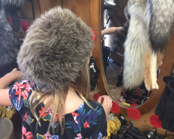 Trying on fur hats is fun for all