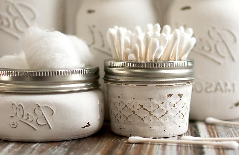 Repurposed mason jars for the bathroom
