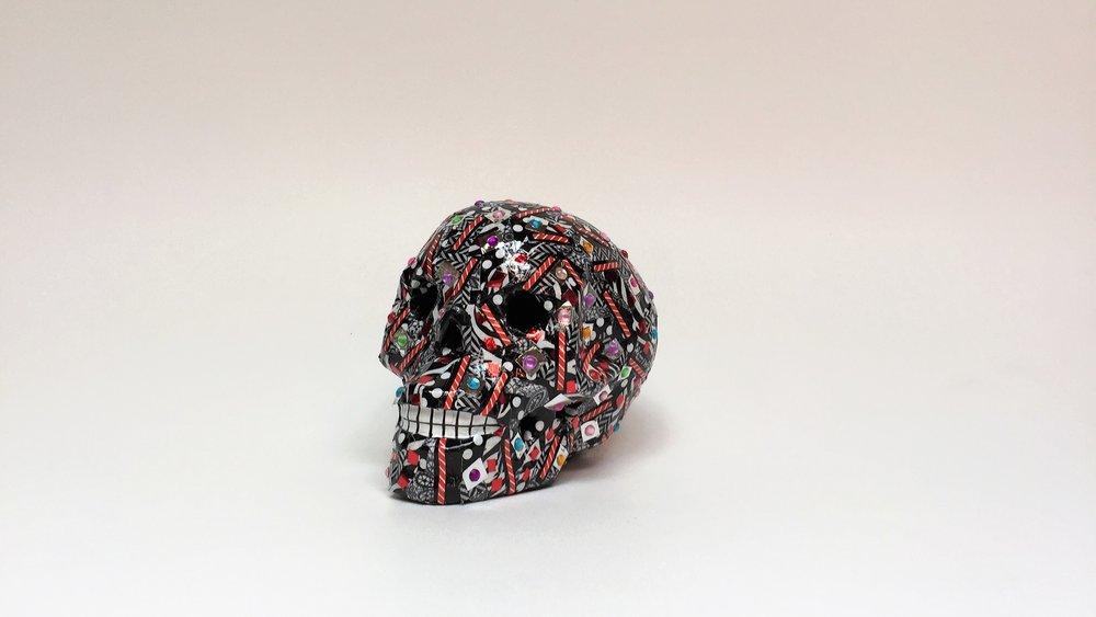 Skull_Black_Red_Facing Left.jpg