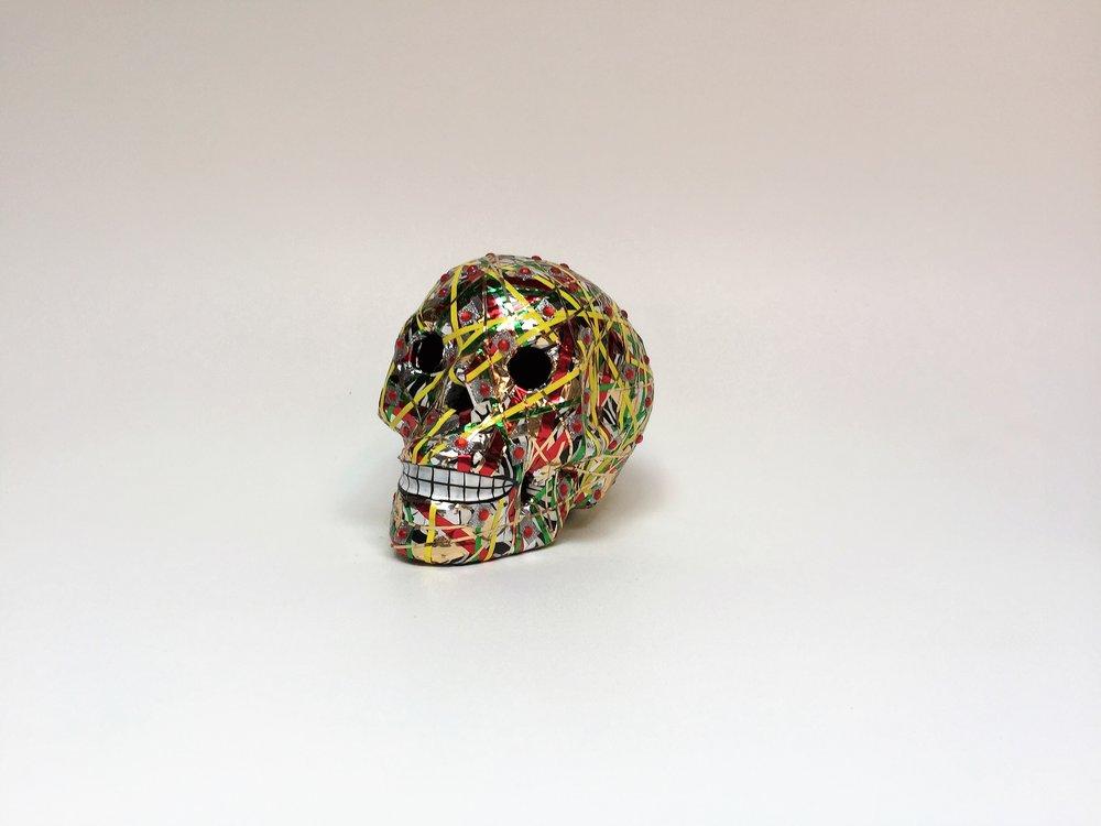 Skull_Yellow_Green_Facing Left.jpg