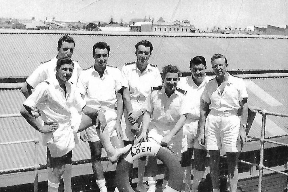 Ken (centre, back) on his second voyage with other Engineers and Officers aboard SS Aden in 1955. Mo is standing to Ken's right.