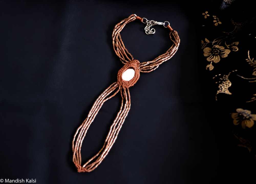 Raina ring bracelet  Embroidered mirror with brass beaded chains in terracotta.