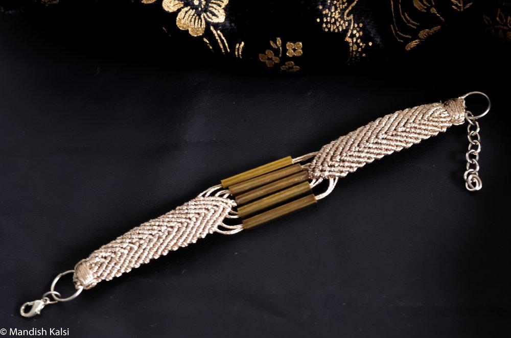 Enam bracelet  White gold macrame with brass beads.