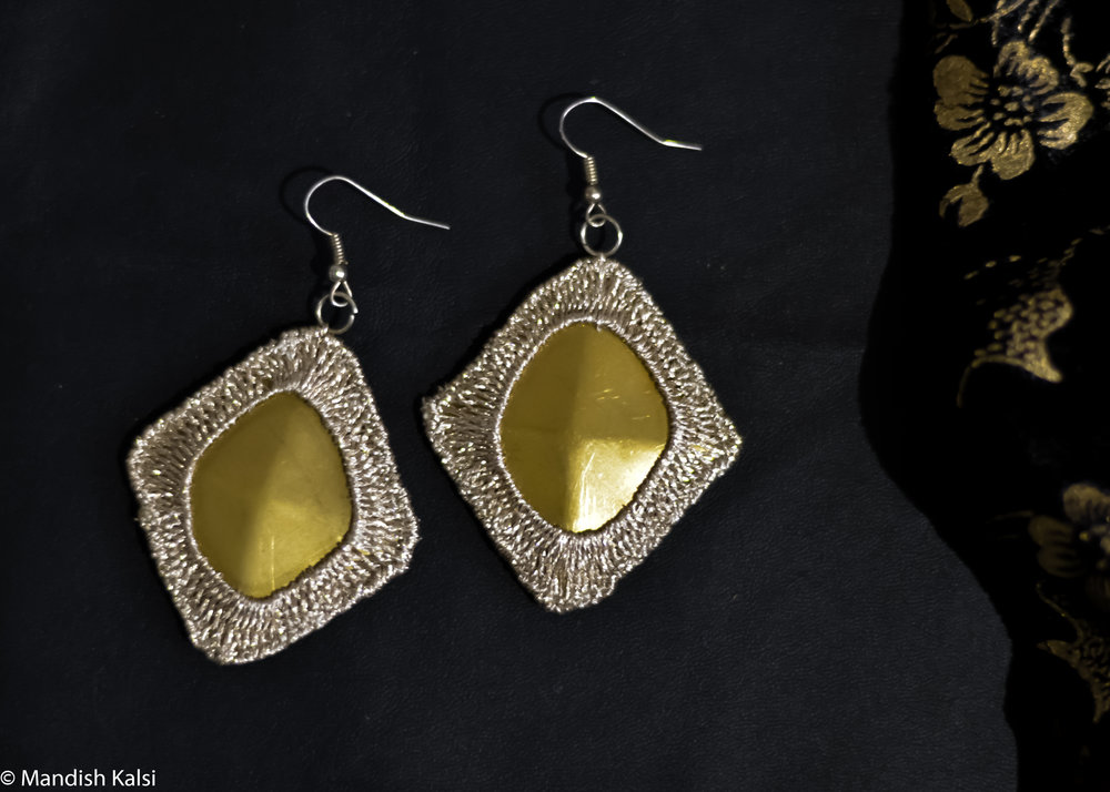 Cleopatra earrings  Embroidered brass plates.