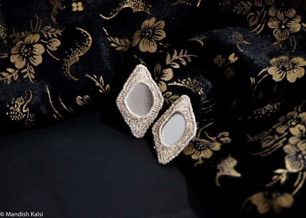 Diamond studs  Embroidered mirrors.