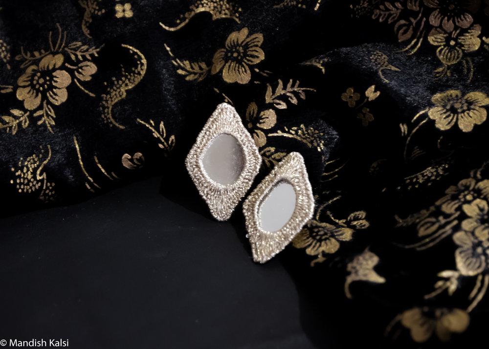 Diamond studs  Embroidered mirrors.