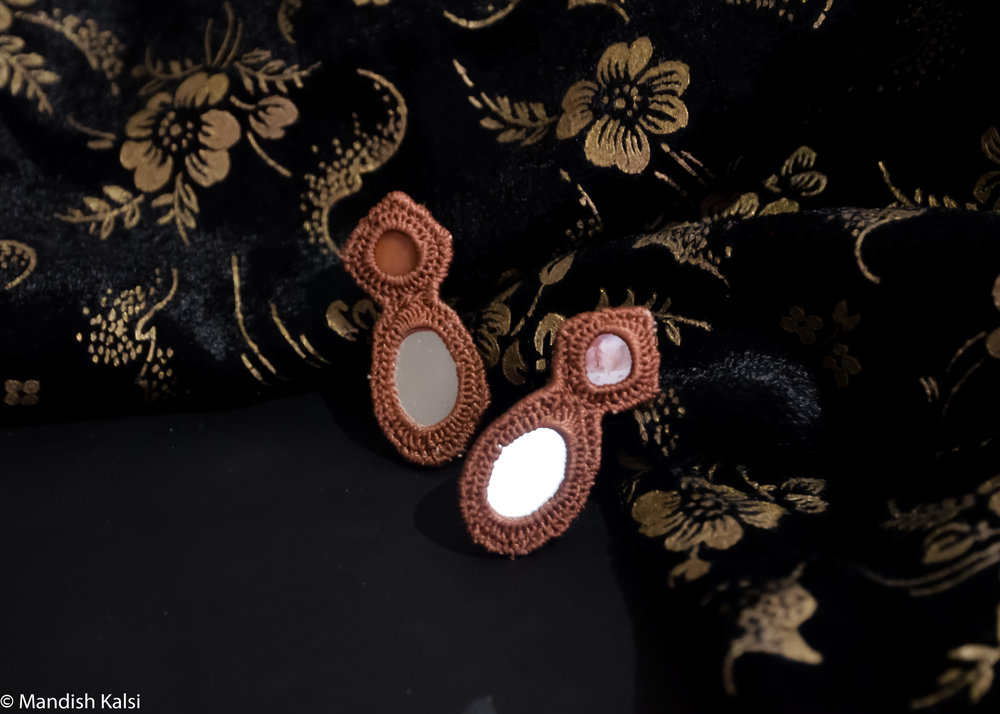 Ela studs  Embroidered mirrors.