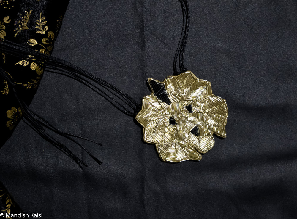 Lion pendant  Goldwork embroidery with adjustable cotton cord chain.