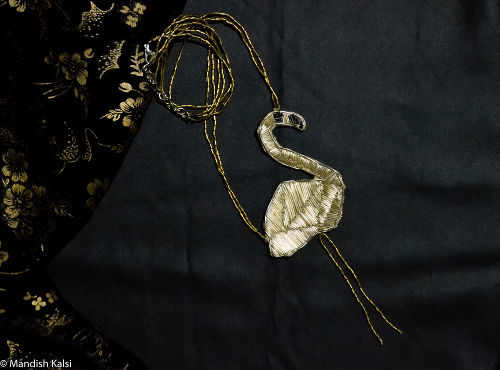 Flamingo pendant  Goldwork embroidery with brass beads